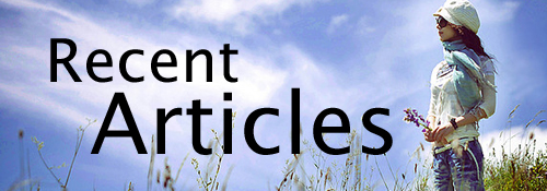 recent articles with a woman standing in a field of wild flowers
